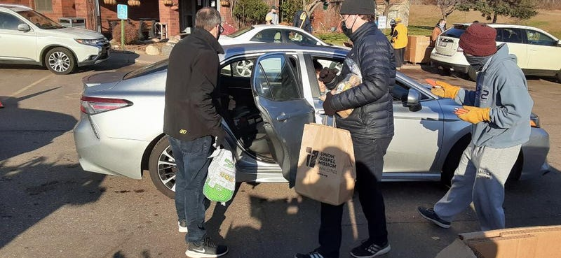 Union Gospel Mission volunteers load up car with Thanksgiving food in annual giveaway