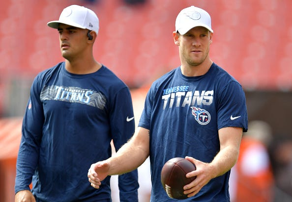 Marcus Mariota and Ryan Tannehill warm up for the Titans.