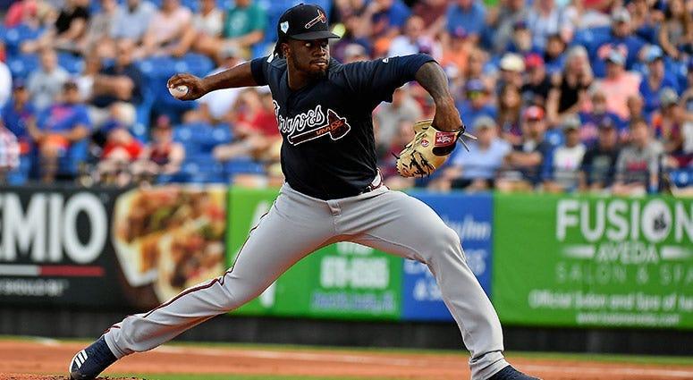Atlanta Braves starting pitcher Touki Toussaint (62) delivers a pitch