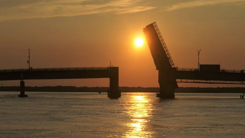 Townsend's Inlet Bridge between Avalon and Sea Isle City, New Jersey at sunset with the drawbridge up for boats to pass below.