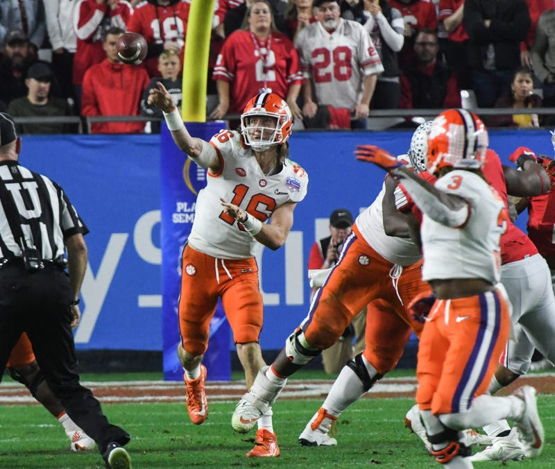 Clemson quarterback Trevor Lawrence (16) throws a pass against Ohio State during the fourth quarter of the PlayStation Fiesta Bowl of the College Football Playoffs semi-final game, at State Farm Stadium in Glendale, Arizona Saturday, December 28, 2019. Cl