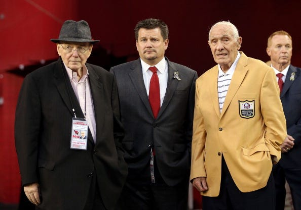 Charlie Trippi (r.) before a Cardinals game in 2012