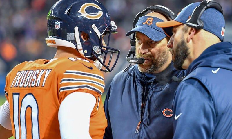 Bears coach Matt Nagy, center, talks with quarterback Mitchell Trubisky (10).