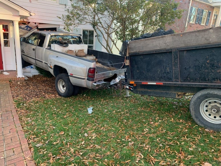 Truck rolls into home, no one injured