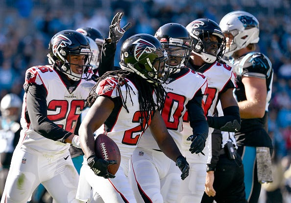 Desmond Trufant celebrates an interceptions with the Falcons.