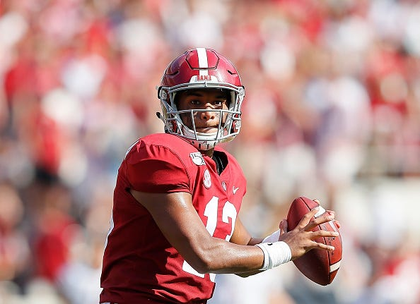 Alabama QB Tua Tagovailoa eyes his receivers down field.