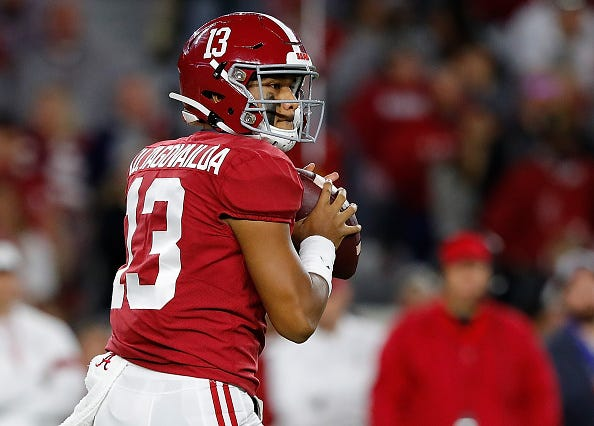 Tua Tagovailoa drops back for a pass with Alabama.