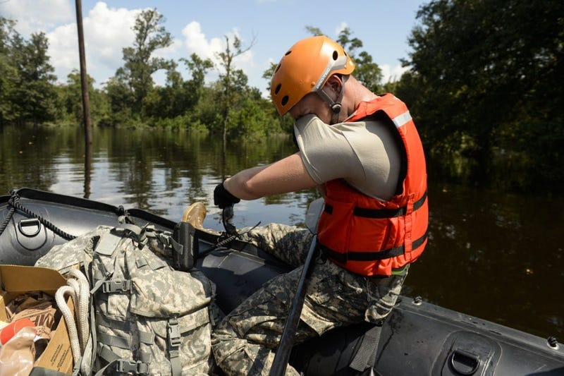 Specialist wipes his eyes as the heat and humidity during a boat patrol in Orange, Texas