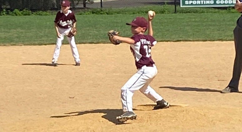 Lower Perk Little League's Erin Eperthener's son, Louie, pitching.