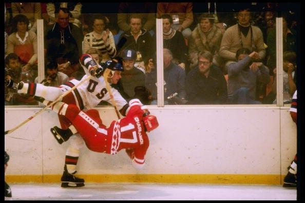 USA's Mike Ramsey pummels into Soviet Union's Valeri Kharlamov.