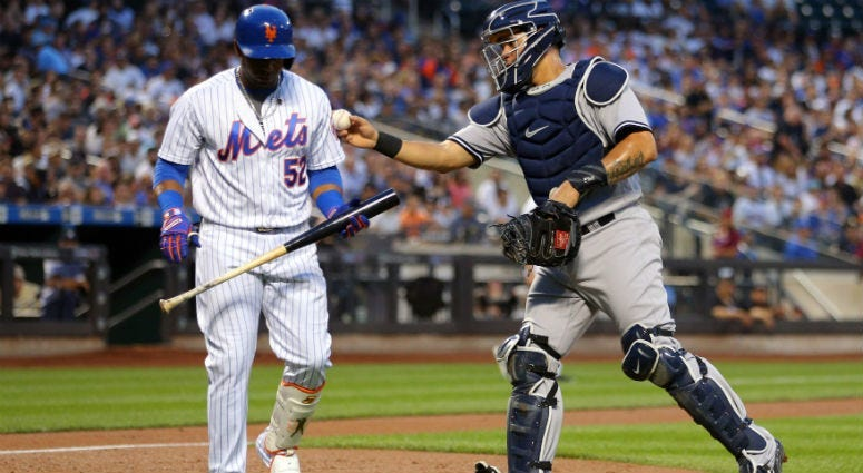 Gary Sanchez tags out Yoenis Cespedes after a dropped third strike during the first inning at Citi Field.