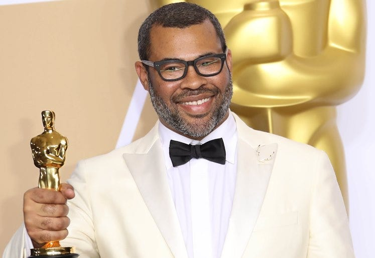 """March 4, 2018; Hollywood, CA, USA; Jordan Peele, winner of the award for best original screenplay for \""""Get Out\"""", poses in the photo room during the 90th Academy Awards at Dolby Theatr"""
