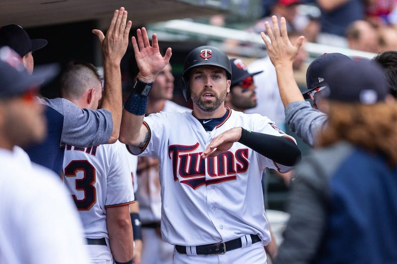 Jake Cave in Twins dugout