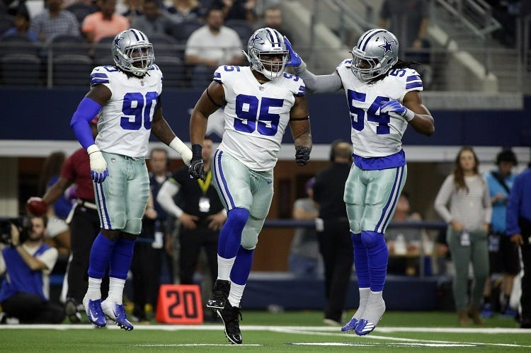 Dallas Cowboys defensive tackle David Irving (95) and linebacker Jaylon Smith (54) celebrate after a play in the first quarter against the Jacksonville Jaguars at AT&T Stadium.