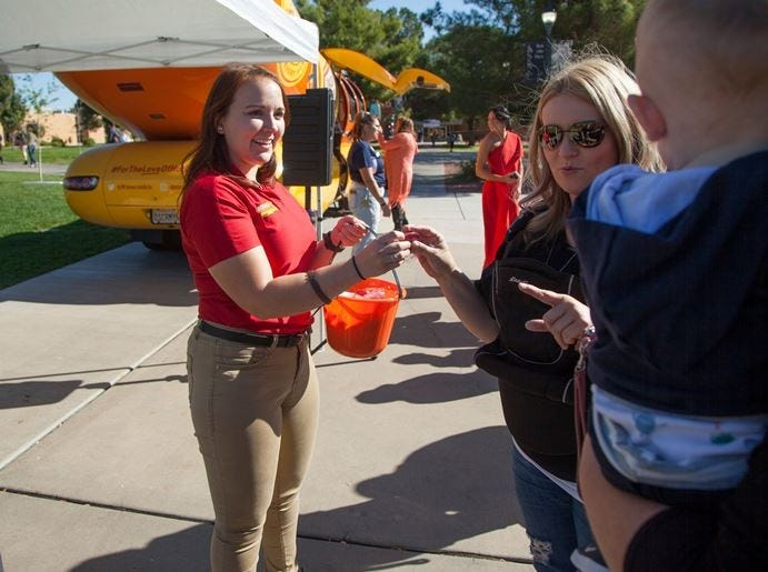 Dixie State University students and members of the community visit the Oscar Mayer Wienermobile at DSU Tuesday, Oct. 30, 2018