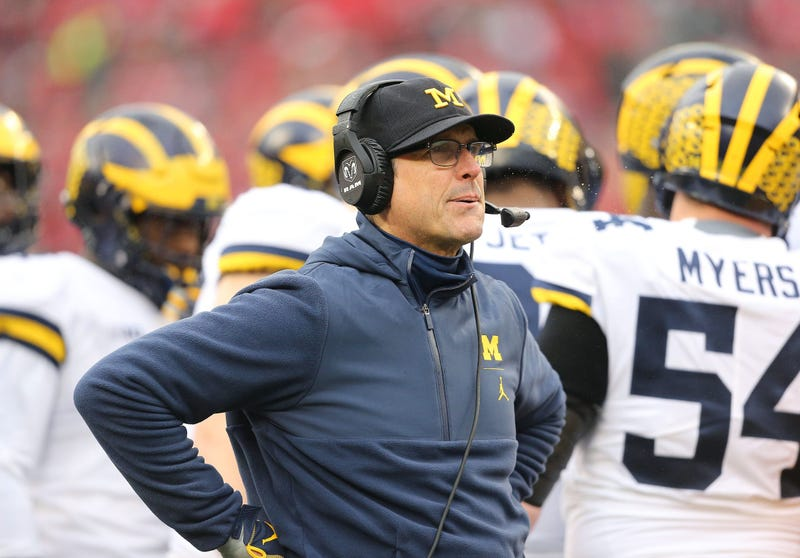 Michigan Wolverines head coach Jim Harbaugh looks up at the scoreboard during the second quarter against the Ohio State Buckeyes at Ohio Stadium.