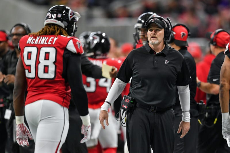 Dec 16, 2018; Atlanta, GA, USA; Atlanta Falcons head coach Dan Quinn reacts with defensive end Takkarist McKinley (98) on the sideline against the Arizona Cardinals during the first half at Mercedes-Benz Stadium. Mandatory Credit: Dale Zanine-USA TODAY Sp