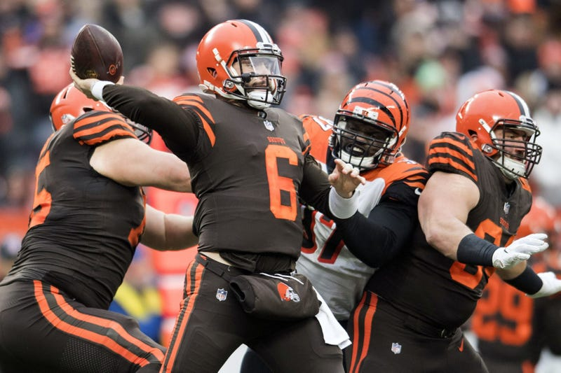 Dec 23, 2018; Cleveland, OH, USA; Cleveland Browns quarterback Baker Mayfield (6) throws a pass as Cincinnati Bengals defensive tackle Geno Atkins (97) rushes during the second half at FirstEnergy Stadium. Mandatory Credit: Ken Blaze-USA TODAY Sports