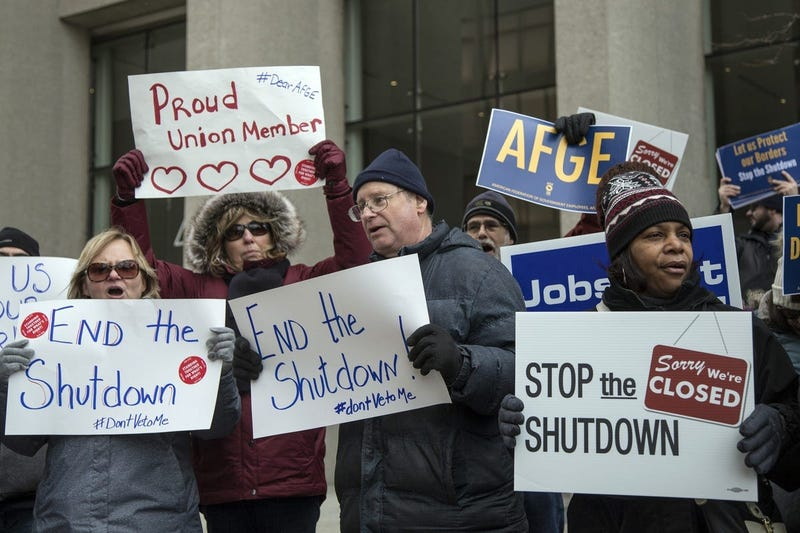 Federal employees with their family and friends protest the government shutdown.