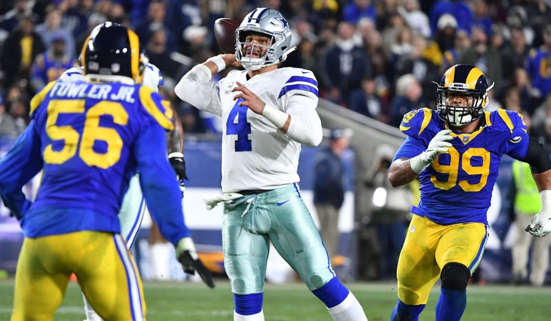 Jan 12, 2019; Los Angeles, CA, USA; Dallas Cowboys quarterback Dak Prescott (4) passes against the Los Angeles Rams in the third quarter in a NFC Divisional playoff football game at Los Angeles Memorial Coliseum.