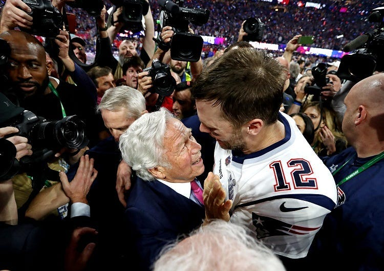 New England Patriots quarterback Tom Brady (12) celebrates with New England Patriots owner Robert Kraft after the Los Angeles Rams in Super Bowl LIII at Mercedes-Benz Stadium.