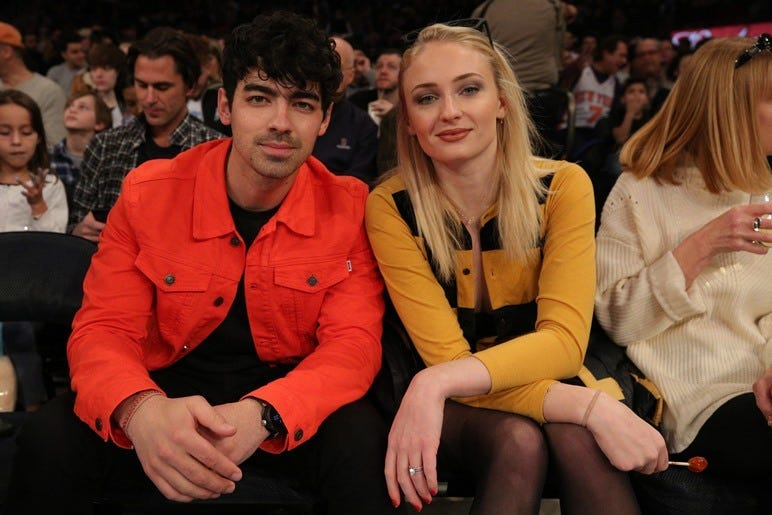 Mar 9, 2019; New York, NY, USA; American musician Joe Jonas (left) sits with British actress Sophie Turner during the first quarter between the New York Knicks and the Sacramento Kings at Madison Square Garden. Mandatory