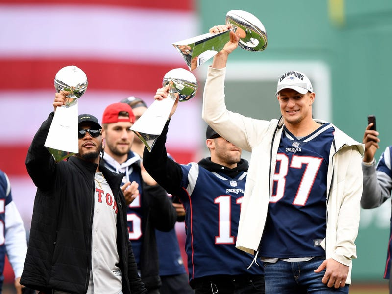 Rob Gronkowski holds up a Lombardi Trophy