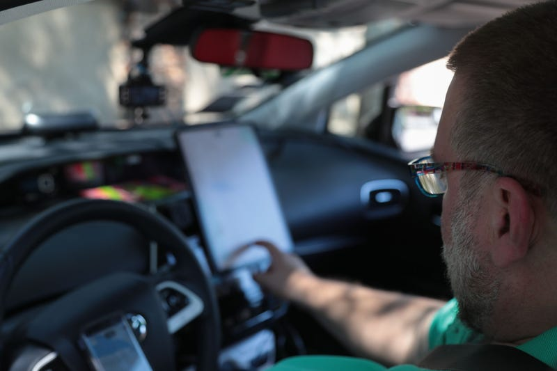 Kenneth Martinson checks his driving apps before starting to work in Palm Springs during the first weekend of Coachella, April, 13, 2019.