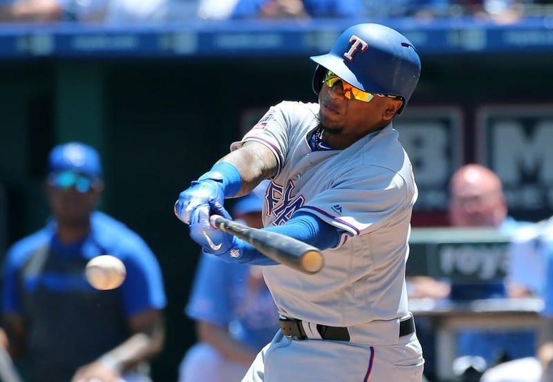 May 16, 2019; Kansas City, MO, USA; Texas Rangers left fielder Willie Calhoun (5) hits an RBI single against the Kansas City Royals in the fifth inning at Kauffman Stadium.