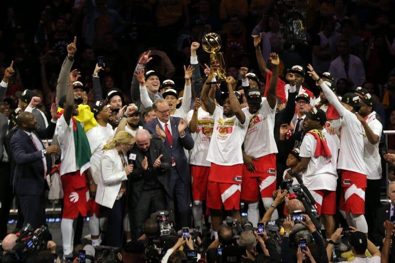 Jun 13, 2019; Oakland, CA, USA; Toronto Raptors forward Kawhi Leonard (2) lifts up the Larry O'Brien Championship Trophy after defeating Golden State Warriors for the NBA Championship in game six of the 2019 NBA Finals