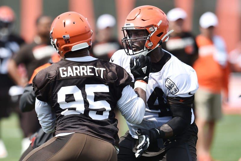 Cleveland Browns defensive end Myles Garrett (95) rushes against offensive tackle Chris Hubbard (74) during training camp at the Cleveland Browns Training Complex.