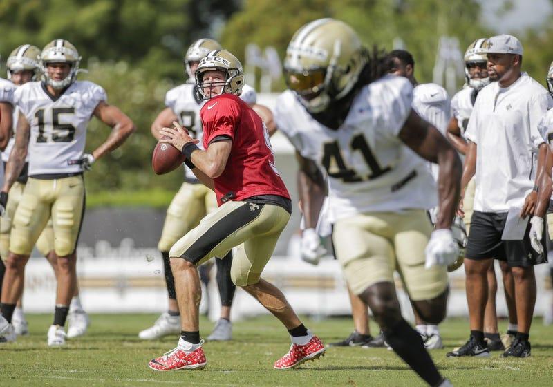 Jul 28, 2019; Metairie, LA, USA; New Orleans Saints quarterback Drew Brees (9) throws to running back Alvin Kamara (41) during training camp at the Ochsner Sports Performance Center.