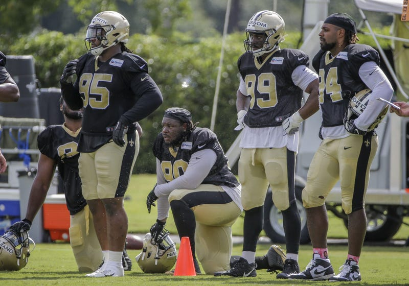Jul 28, 2019; Metairie, LA, USA; New Orleans Saints defensive tackle Taylor Stallworth (95) and defensive tackle Malcom Brown (90) and defensive end Geneo Grissom (99) and defensive end Cameron Jordan (94) look on during training camp at the Ochsner Sport