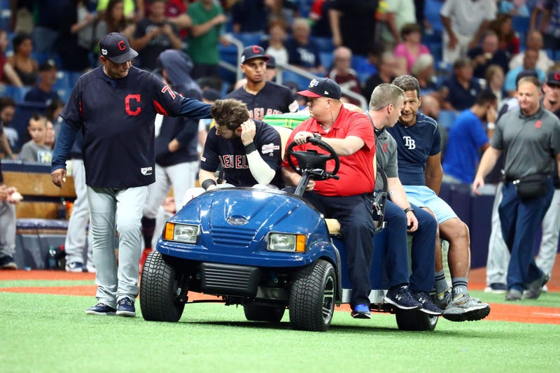 Aug 30, 2019; St. Petersburg, FL, USA; Cleveland Indians right fielder Tyler Naquin (30) is greeted by manager Terry Francona (77) while being carted off the field after an apparent injury at the end of the fifth inning against the Tampa Bay Rays at Tropi