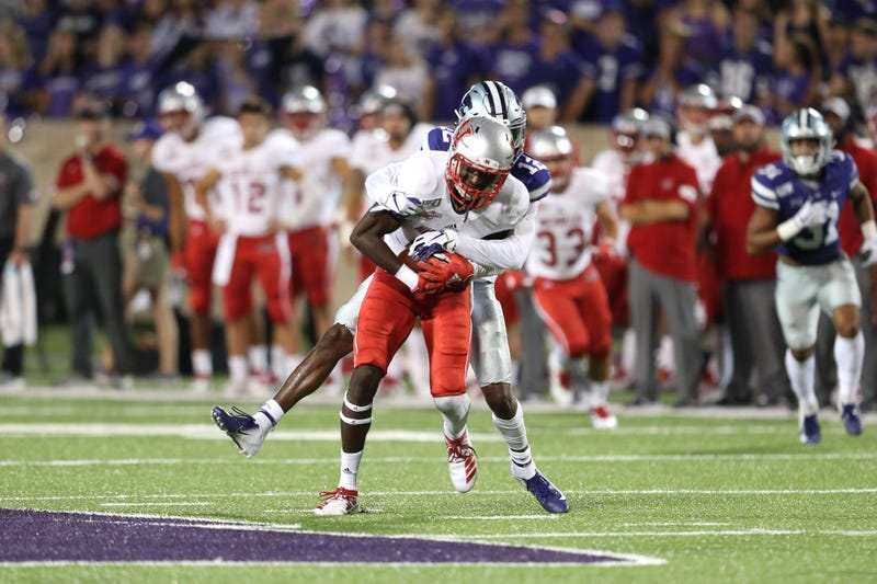 Nicholls State Colonels wide receiver Dai'Jean Dixon (5) is tackled by Kansas State Wildcats defensive back AJ Parker (12) during the fourth quarter at Bill Snyder Family Stadium.