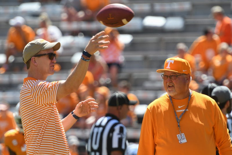 NFL former quarterback Peyton Manning and Tennessee Volunteers equipment manager Roger Frazier speak prior to the game against the Georgia State Panthers at Neyland Stadium.