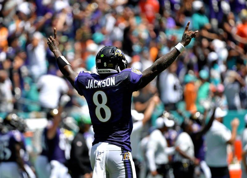 Lamar Jackson celebrates a touchdown pass