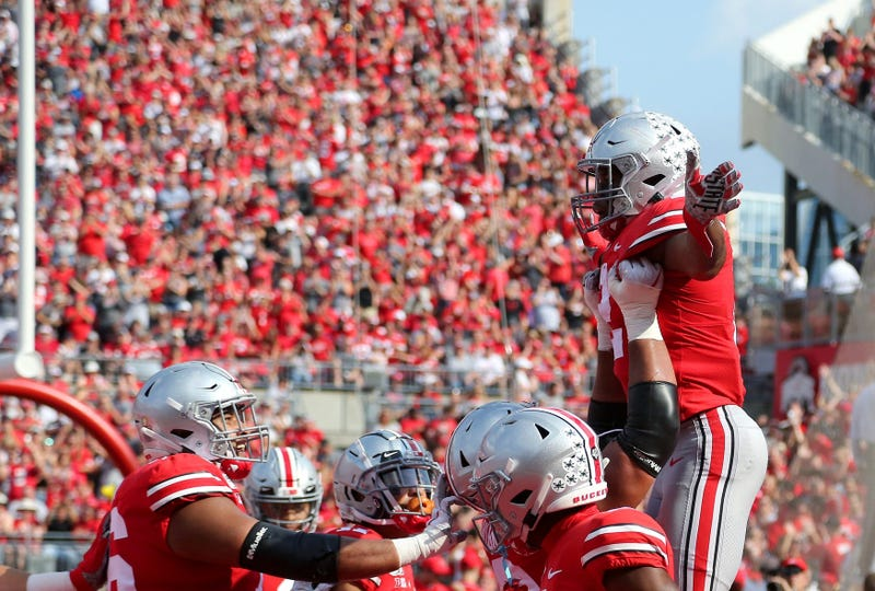 Ohio State Buckeyes running back J.K. Dobbins (2) celebrates after scoring a touchdown against the Miami (Oh) Redhawks during the second quarter at Ohio Stadium.