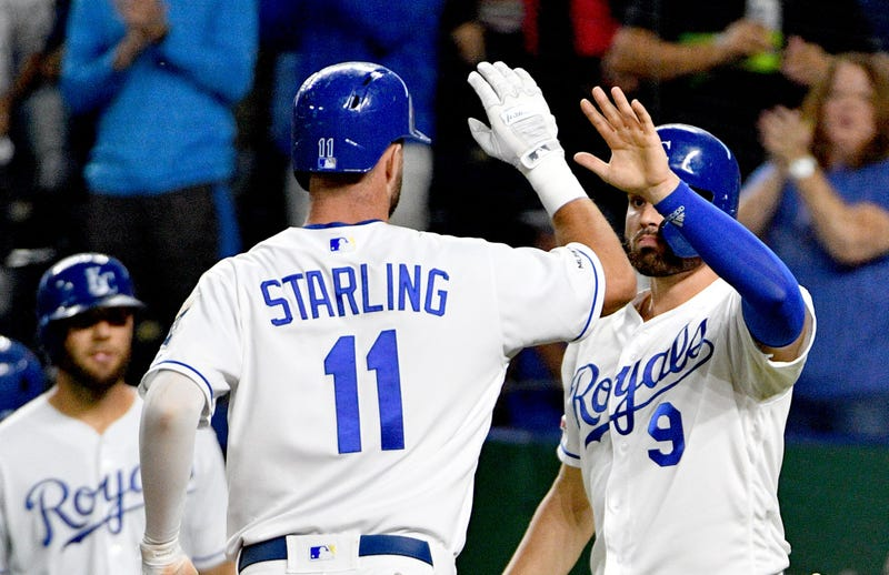 Sep 24, 2019; Kansas City, MO, USA; Kansas City Royals center fielder Bubba Starling (11) is congratulated by right fielder Ryan McBroom (9) after scoring in the third inning against the Atlanta Braves at Kauffman Stadium. Mandatory Credit: Denny Medley-U