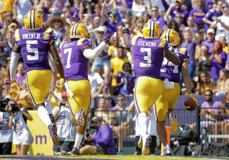 LSU Tigers cornerback Derek Stingley Jr. (24) celebrates with teammates after intercepting a pass against the Utah State Aggies during the first half at Tiger Stadium.