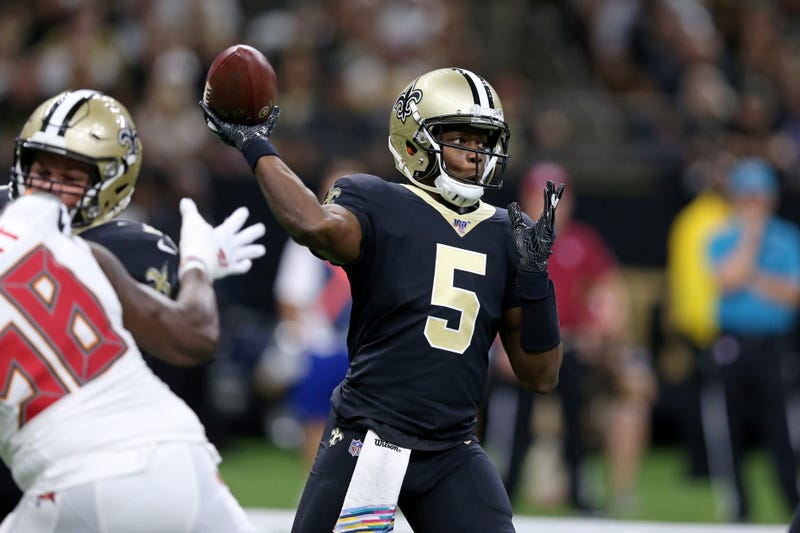 New Orleans Saints quarterback Teddy Bridgewater (5) makes a throw against the Tampa Bay Buccaneers in the first quarter at the Mercedes-Benz Superdome.