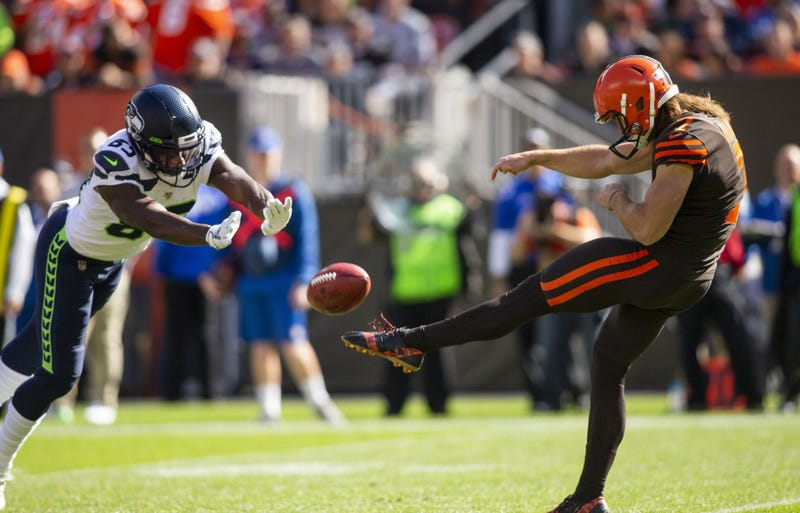 Oct 13, 2019; Cleveland, OH, USA; Seattle Seahawks wide receiver David Moore (83) blocks a punt by Cleveland Browns punter Jamie Gillan (7) during the second quarter at FirstEnergy Stadium. Mandatory Credit: Scott R. Galvin-USA TODAY Sports