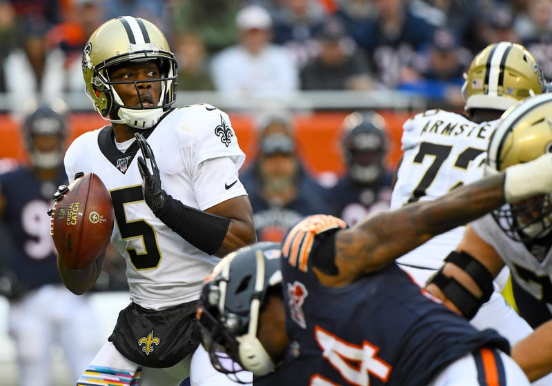 New Orleans Saints quarterback Teddy Bridgewater (5) drops back to a pass against the Chicago Bears during the first half at Soldier Field.