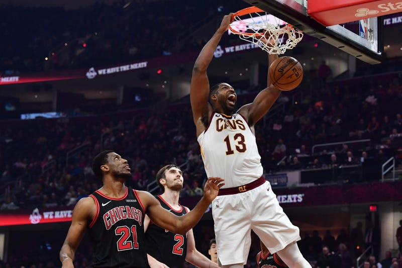 Oct 30, 2019; Cleveland, OH, USA; Cleveland Cavaliers center Tristan Thompson (13) dunks over Chicago Bulls forward Thaddeus Young (21) and forward Luke Kornet (2) during the first half at Rocket Mortgage FieldHouse. Mandatory Credit: Ken Blaze-USA TODAY