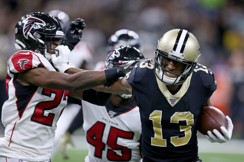 New Orleans Saints wide receiver Michael Thomas (13) pushes Atlanta Falcons strong safety Damontae Kazee (27) away by his facemark in the second quarter at the Mercedes-Benz Superdome. Thomas was called for a facemark penalty.