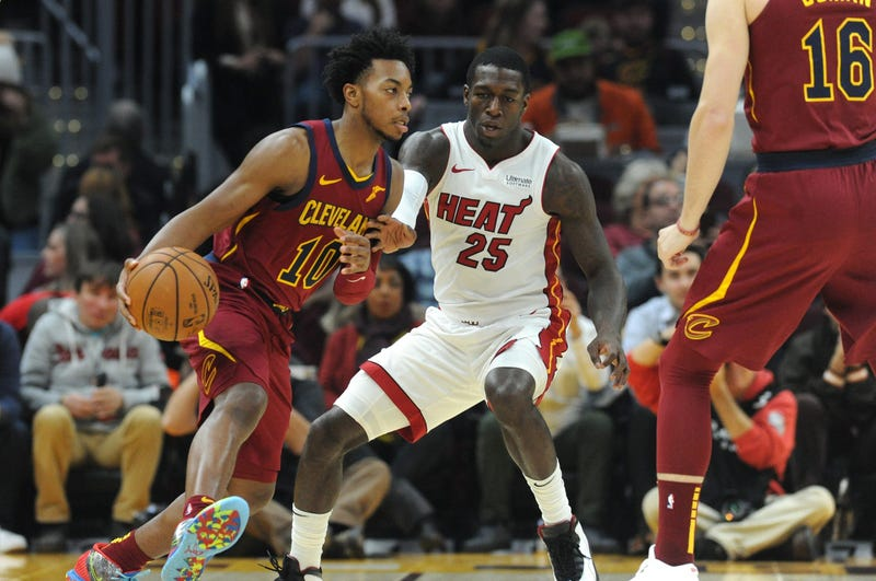 Nov 14, 2019; Cleveland, OH, USA; Cleveland Cavaliers guard Darius Garland (10) moves the ball against Miami Heat guard Kendrick Nunn (25) during the first quarter at Rocket Mortgage FieldHouse. Mandatory Credit: Philip G. Pavely-USA TODAY Sports