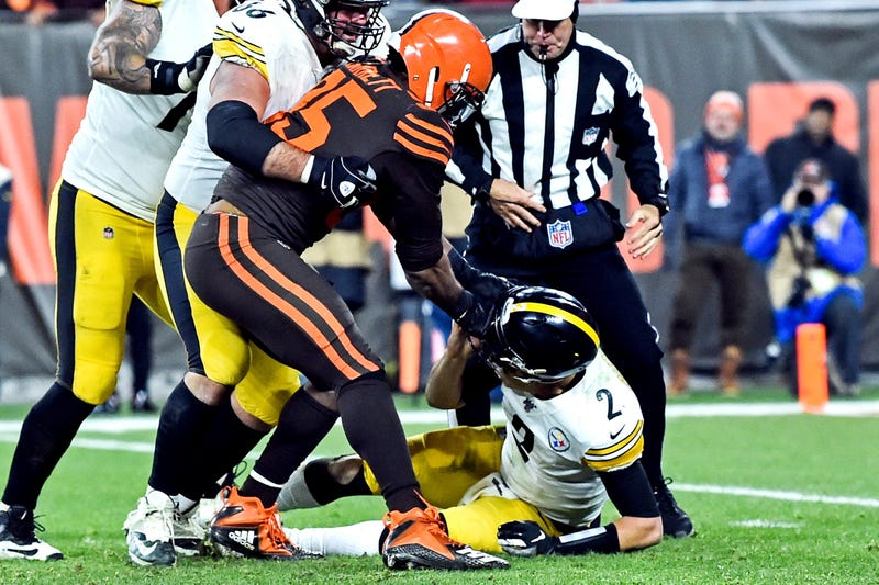 Nov 14, 2019; Cleveland, OH, USA; Cleveland Browns defensive end Myles Garrett (95) hits Pittsburgh Steelers quarterback Mason Rudolph (2) with his own helmet as offensive guard David DeCastro (66) tries to stop Garrett