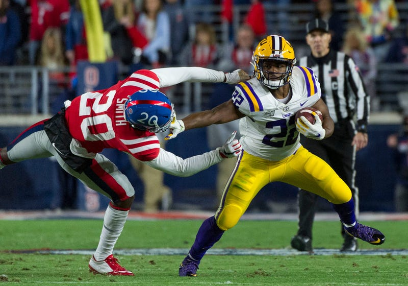 LSU Tigers running back Clyde Edwards-Helaire (22) stiff arms Mississippi Rebels defensive back Keidron Smith (20) during the first half at Vaught-Hemingway Stadium.