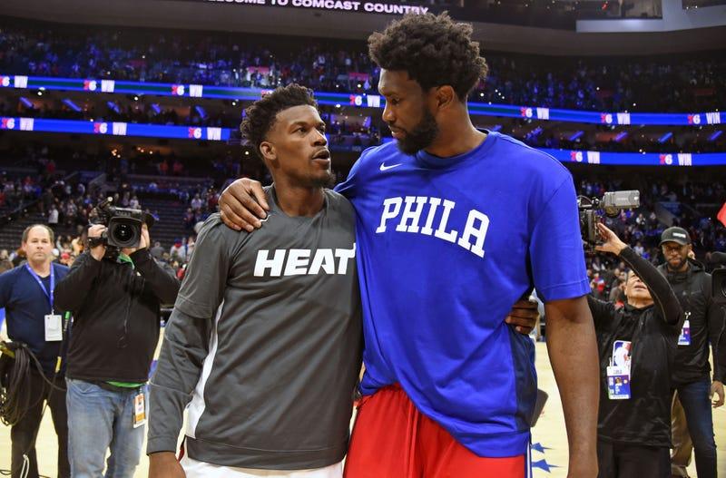 Miami Heat forward Jimmy Butler (22) and Philadelphia 76ers center Joel Embiid (21)