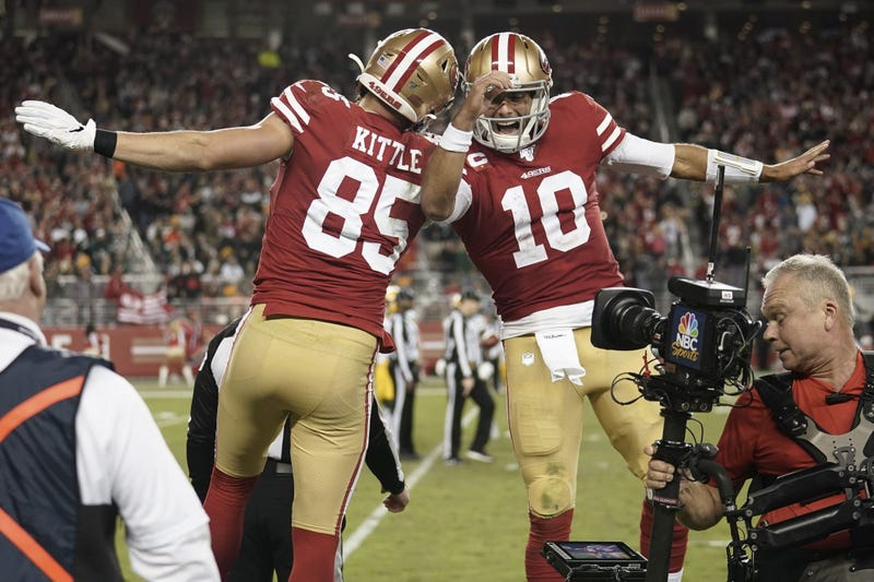 George Kittle and Jimmy Garoppolo celebrate win